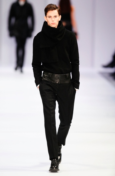 BERLIN, GERMANY - JANUARY 17:  A model walks the runway at Hugo By Hugo Boss Autumn/Winter 2013/14 fashion show during Mercedes-Benz Fashion Week Berlin at Opernwerkstatte on January 17, 2013 in Berlin, Germany.  (Photo by Peter Michael Dills/Getty Images for Mercedes-Benz)
