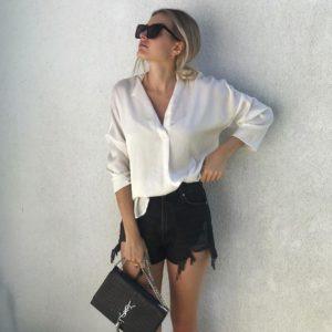 weißestain bluse schwarze levis jeans ysl kroko tasche schwarze sonnenbrille sophie pirrung